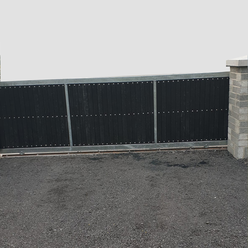 sliding steel gate with plastic panels custom design ireland Next Generation Plastics